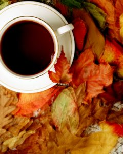 Cup and Saucer with autumn leaves, overhead view